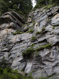 Mountainside ledge. A look up at a smooth rocky ledge Stock Images