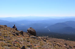 On the Mountainside. A man takes in the breathtaking view at 7500ft, Mount Hood, Oregon Stock Images