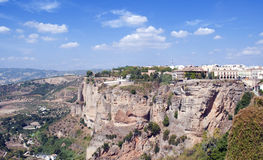 Mountainside of Ronda. Mountainside in the Spanish town of Ronda in the province of Malaga. skies are cloudy, and a landscape of shrubs in the background Royalty Free Stock Photos