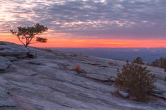 Mountainside of Stone Mountain at sunset, Georgia, USA. The beautiful view of the mountainside of Stone Mountain with pine tree and red horizon at sunset Royalty Free Stock Photos