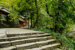 Mountainside stone steps before aged Chinese buildings in winter Royalty Free Stock Photos
