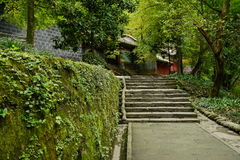 Mountainside stone steps before ancient Chinese buildngs in afte Stock Photo