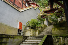 Mountainside stone stpes between ancient Chinese buildings in wo Royalty Free Stock Photography