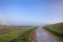 Mountainside Uphill Walking Path On A Foggy Morning Royalty Free Stock Photography