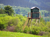 Mountainside watchtower. Wooden watchtower built on a mountain side, overlooking forest and woods royalty free stock photos