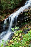 Mountainside waterfall. A view of a natural mountainside waterfall stock photography