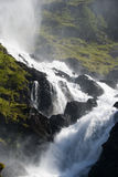 Mountainside waterfall Stock Photo