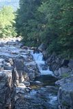 Mountainside waterfall in New Hampshire, USA royalty free stock photography