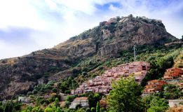 Mountaintop castle. A view looking up to a mountaintop castle in Taormina, Sicily Stock Image