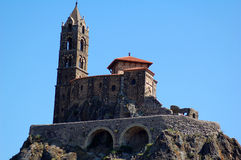 Mountaintop cathedral in France. The 12-century cathedral Notre-Dame of Le Puy sits atop the mountain Mon Anicius in the city of Le-Puy-en-Velay, in central Stock Photography