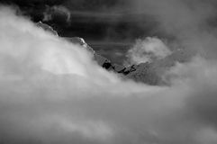 Mountaintop through clouds Royalty Free Stock Images