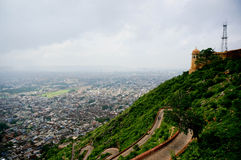Mountaintop fort overlooking city on a cloudy day. The mountaintop fort of Nargarh overlooking the city of Jaipur, Rajasthan India on a monsoon day. The twisted Stock Images
