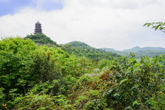 Mountaintop tower in cloudy spring sky Stock Image