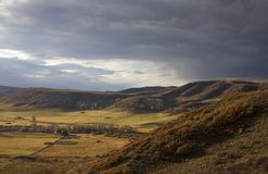 Mountaintop view. View of a scenic ranch below from a high ridgeline Royalty Free Stock Photo