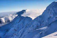Snowy Mountains Tatras Slovakia. Snowy mountains covered with clouds Tatras Slovakia Stock Photos