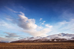 Mountais on the blue cloudy sky. Altay Stock Images
