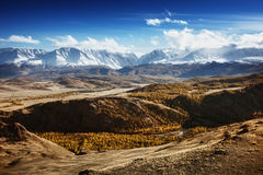 Mountais on the blue cloudy sky. Altay Stock Photography