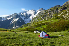Mountaneer bivouac in mountains Stock Image
