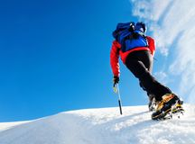 Mountaneer climbs on a glacier. Sunny clear day. Mont Blanc, Cha Stock Images
