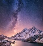 Mountans and reflection on the water surface at the night time. Sea bay and mountains at the night time. Milky way above mountains stock image
