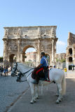 Mounted Carabinieri in front of Arch of Constatntine. ROME, ITALY - 2 JULY 2016: Carabinieri on horseback stand guard in front of the Arch of Constantine with Royalty Free Stock Images