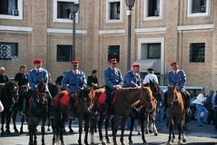 Mounted constabulary in Rome. St. Peters square before the Speech of the Pope in the square at St. Peters Basilica, Mounted police, Priest on horseback Royalty Free Stock Image