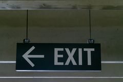 Mounted metal exit sign, and arrow pointing to the left stock image