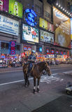 Mounted NYPD Policemen on horses in Times Square at night, the famous location in New York city Royalty Free Stock Photo