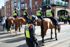 Mounted police cordon the streets. June 8, 2013, English Defence League and United Against Fascism protest, Sheffield, UK Royalty Free Stock Photos