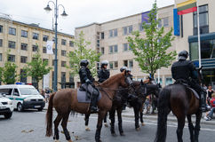 Mounted police keep public city event Royalty Free Stock Photos