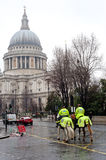 Mounted Police Officers in London. Mounted Police Officers patrol the streets near St. Paul's Cathedral in London on March 23, 2013. The Mounted Branch has a Stock Image