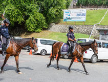 Mounted police patrol. Historic Malaka, Malaysia Stock Photo