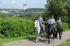 Mounted police patrol Moscow park Royalty Free Stock Photos