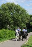 Mounted police patrol Moscow park Stock Photo