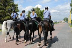 Mounted police patrol Moscow park Stock Image