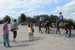 Mounted police patrol Moscow park Stock Photography