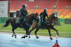 Mounted police patrol at the Moscow stadium. Stock Photography