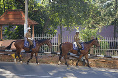 Mounted police on patrol in the streets of Kandy. Sri Lanka Royalty Free Stock Photo