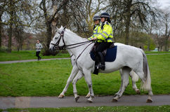 Mounted police women riding in Hyde Park, London Royalty Free Stock Images