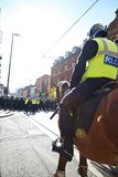 Mounted policeman prepares to charge. June 8, 2013, English Defence League and United Against Fascism protest, Sheffield, UK Royalty Free Stock Photo