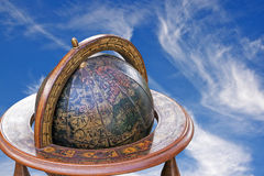 Mounted Retro World Globe Against Blue Cloudy Sky Royalty Free Stock Photos