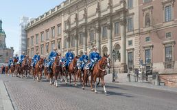 Free Mounted Royal Guards In Uniforms And Silver Helmets Riding The Horses On Square Of Old Town Royalty Free Stock Photos - 119729018