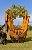 Machine which Removes and transplants a a tree Royalty Free Stock Photos