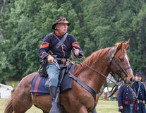 Mounted Support. Civil War era soldiers in battle at the Dog Island reenactment in Red Bluff, California stock images