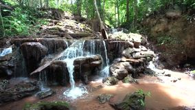 Waterfall in the forest of Thailand. In the mounten of thailand in the forest there is an beautiful waterfall stock footage