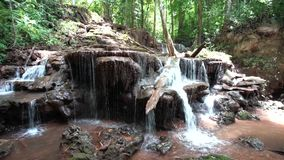 Waterfall in the forest of Thailand. In the mounten of thailand in the forest there is an beautiful waterfall stock video footage
