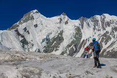 Climbers on the glacier in the remote snow mountains route