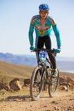 Mountian biker on desert mountain race Royalty Free Stock Photography