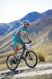 Mountian biker on desert mountain race Royalty Free Stock Photography