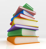 Mountian of Books. Low perspective view of a towering pile of colourful books. 3D rendered isolated on white background Royalty Free Stock Photo